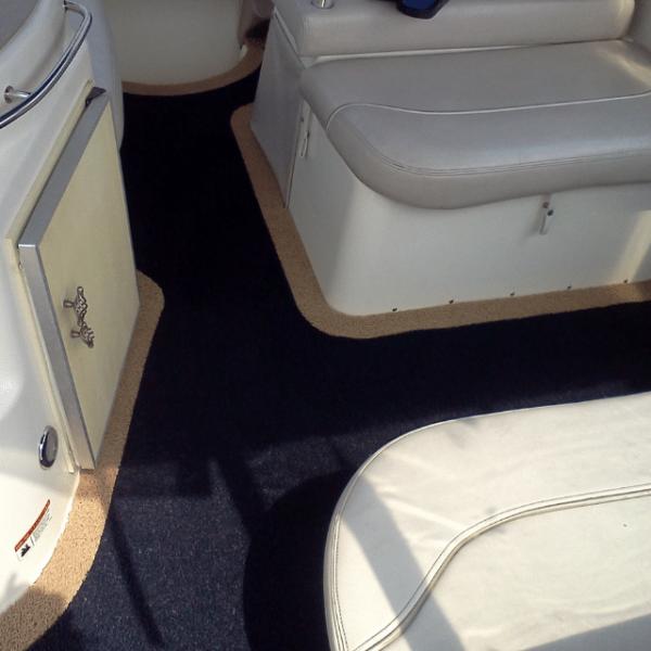 Blue DECKadence boat carpet displayed on a boat