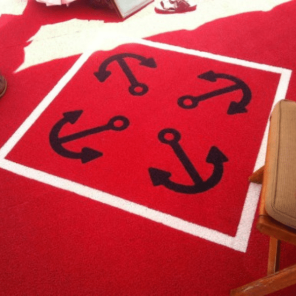 DECKadence boat carpet in red color displayed on a boat