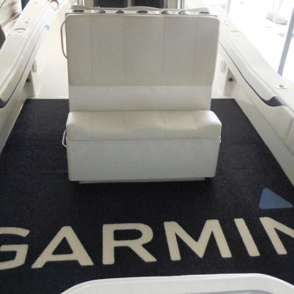 DECKadence boat carpet displayed on a boat