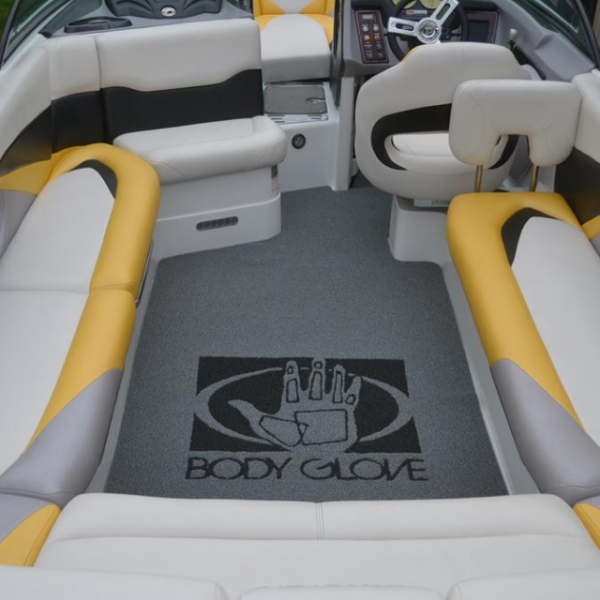 DECKadence boat carpet displayed on a boat with logo