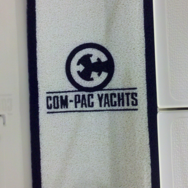 White DECKadence carpet with logo on a boat